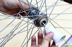 How to Make a Bike Wheel Chandelier. Do you have an old bicycle rim hanging around your house? Are you a bike enthusiast looking for a new décor for your ceiling? Why not make a chandelier from an old bike rim? Find an old bike rim. Bicycle Decor, Bicycle Rims, Old Bicycle, Bicycle Wheel, Old Bikes, Bike Wheels, How To Make A Chandelier, Mustang Wheels, Rim Light