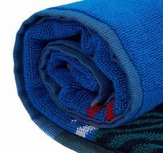This is a superior quality cotton jacquard woven swim towel featuring an abstract version of Barbour's new Bright True Blue Tartan design.