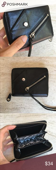 Weekend sale! Rebecca Minkoff leather mini wallet Rebecca Minkoff mini 100% leather wallet. It's small but fits everything you need and it's perfect size for your smaller handbags. Chic exterior with its embellishment make this wallet very unique. See pics for measurements. Excellent condition. Barely used. Rebecca Minkoff Bags Wallets