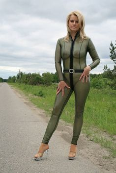 Blonde in transparent latex catsuit outdoors