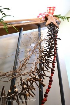 How to make a twig garland, by Funky Junk Interiors - I think I will use small driftwood and twine...hmmm...