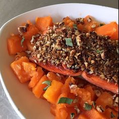 """""""Who's in the mood for a rich @sizzlefishfit dish tonight? @primaldish carmelized @sizzlefishfit sockeye salmon with coconut sugar, topped it with crushed pecans and served it over butternut squash that was roasted with @omgheebutter and seasoned with sage! Delicious!! _______________________________ ‼️You can find our perfectly portioned fish packages on our website: www.sizzlefish.com‼️"""