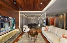 Koray Yavuzer Mimarlık | American Walnut Parke #parquet #parke #woodflooring #parquetflooring #design #livingroom #architect #architecture #interiordesign #interior #homedesign #livingroom #wallpannel #walldesign #hungarianherringbone | LANTANA PARKE