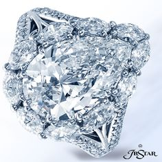 2709-003 - Stunning diamond ring featuring a pear-shape diamond, encircled by perfectly matched marquise and set in a platinum micro pave split shank