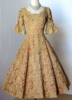 1950s cocktail dress ...taupe colored lace backed by a nude tulle with an additional darker lining, chevron seamed, flared sleeves, via etsy.