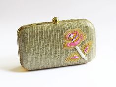 A personal favorite from my Etsy shop https://www.etsy.com/listing/232708238/rose-flower-gold-box-clutch-bag