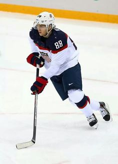 Patrick Kane of handles the puck against Slovakia during the Men's Ice Hockey Preliminary Round Group A game on day six of the Sochi 2014 Winter Olympics at Shayba Arena on February 2014 in Sochi, Russia. Team Usa Hockey, Hot Hockey Players, Olympic Hockey, Ice Hockey Teams, Blackhawks Hockey, Pittsburgh Penguins Hockey, Nhl Players, Chicago Blackhawks, Hockey Stuff