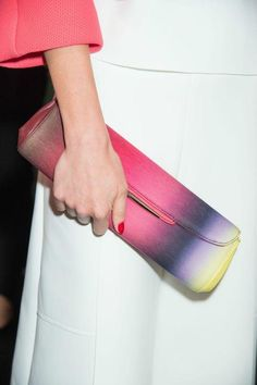 Carolina Herrera clutch and red nails