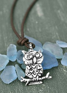 "Owls are all the rage!!! This adorable owl pendant reads ""be wise""on the back and hangs from a brown leather cord. 18""-19"" length"