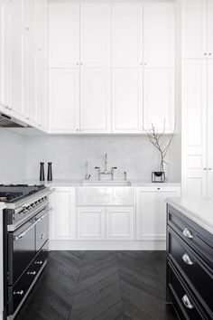 I LOVE monochrome. (Don't like the details on the doors) DO like the double height cupboards. I'll need this to make up for they lost cupboards when I knock through the sitting room wall