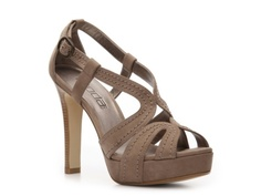 a shoe like this might work, the heel is a bit thicker so maybe it wouldn't sink into the ground as much??