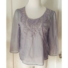 """{urban outfitters} 'sparkle & fade' top Beautiful and classy pale blue sheer 3/4 sleeved top from urban outfitters. Brand is sparkle and fade. Has a lace inset on front. Size small, with no stretch. Good used condition.  Length is approx 21"""" and chest is approx 18"""" Urban Outfitters Tops"""