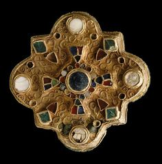 Fibula. Merovingian - seventh century. Gold, pearl, garnet and glass paste…