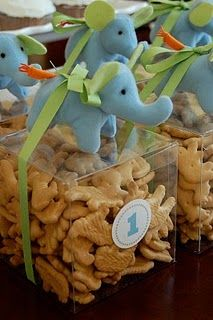 Adorable favor for a circus party or a baby shower, clear boxes of animal crackers, trimmed with a ribbon and a tiny stuffed elephant!    #party favors #favors