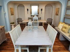 This eclectic dining room, with whitewashed woods and shades of blue, is a fresh, inviting space. Two dining tables and a built-in bench provide ample seating for entertaining guests. Acacia Flooring, Wood Panel Walls, Wood Paneling, Whitewash Wood, Weathered Wood, Built In Bench, Floor Colors, Dining Room Design, Inspired Homes