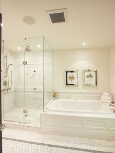 .I like the full glass and tile height and detail around tub and  floor here which would work in the shape of the room