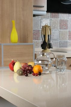 Totem Quartz surfaces do not have any pores or cracks on them, so there is no need for coatings at all.  www.totemquartz.com