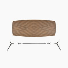Manta table in the boat-shaped version with four legs, with brushed lead structure and top in the walnut finish.
