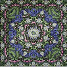 quilt in purple, green, grey and white
