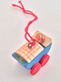 German Wooden Christmas Ornament - Baby In Carriage