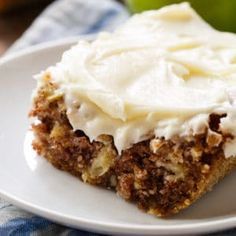 German Apple Cake has chunks of fresh apple, lots of fall spices, crunchy pecans, and a thick layer of cream cheese frosting.