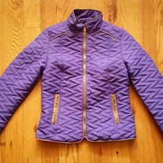 Purple quilted jacket with tan piping NWT A great little jacket with a tailored look. Bright brass zippers and tan cord piping to offset the gorgeous purple color. Sleeves are knuckle length on me. Brand new! th j Jackets & Coats Puffers