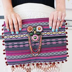 Tribal Pom Pom Zip Clutch Funky and fun Pom Pom clutch with fun embellishment perfect for any music festival or night out on the town! New, never been worn from my boutique. Reasonable offers only, no trades. Bundle with 3 items for 20% off ✨ Bags Clutches & Wristlets
