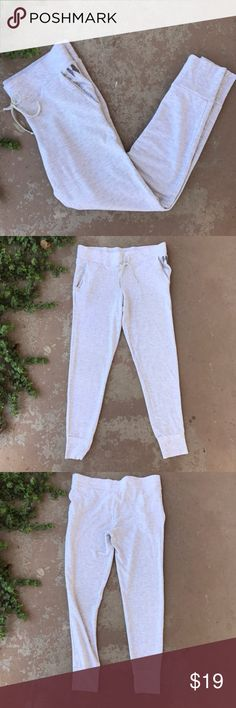 "Victoria's Secret VS Heather Gray Soft Sweat Pants Soft sweatpants by Victoria Secret with the classic wings logo on the right pocket. Features a drawstring and cuffs that fit at the ankle. Gently worn but in great condition with lots of life left! Size small with an approximate 28"" inseam. Victoria's Secret Pants Leggings"
