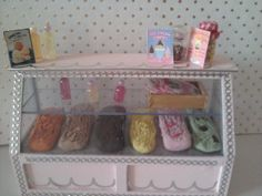 Dolls house ice-cream shop display counter 1 12th scale miniature. £15.00, via Etsy.