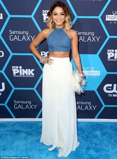 Vanessa Hudgens wowed the blue carpet at the 2014 Young Hollywood Awards in a custom blue halterneck crop top by Bongo and white high-waist flaring trousers by Badgley Mischka http://dailym.ai/1nREkCI