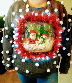 Home made, ugly, festive, Christmas sweater, snow globe. made from a plastic bowl, white felt pom poms and battery operated lights.