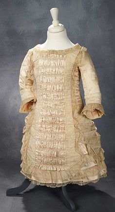 """What Finespun Threads"" - Antique Doll Costumes, 1840-1925 - March 12, 2017: 141 Child's Ivory Silk Dress with Elaborate Construction, for Grand-Sized Doll"