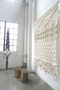 Textile artist Sally England takes macramé to a new level  with her hand-knotted ceiling-to-floor hangings.