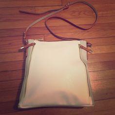 CROSSBODY BAG Adorable crossbody bag in white. Brand new and never worn! Perfect for summer outings and traveling! Bags Crossbody Bags