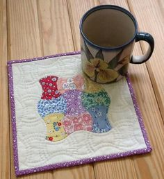 "My mug rug that I made for an upcoming swap!  I used 1930s reproduction fabrics, aged muslin for background.  English Paper Pieced the 2"" apple cores and hand quilted.  Completed size is just shy of 9"" square."