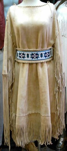 Light gold suede deer hide dress with a loom beaded belt http://nativeamericanstuff.net/Native%20American%20Style%20Crafted%20Clothing%20buckskins%20outfits%20moccasins%20and%20Handbags.htm