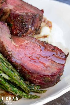 Are you looking for special occasion holiday beef recipes for a crowd? This smoked beef tenderloin with maple shallot marinade is the perfect roast to serve the family for Christmas, Thanksgiving, or New Years! This marinade recipe enhances the meat with a sweet maple herbaceous twist that is perfect for pairing with your favorite holiday recipes. Get the full guide now on UrbanCowgirlLife.com | Tailgating Recipes, Barbecue Recipes, Spicy Recipes, Grilling Recipes, Wine Recipes, Beef Recipes, Real Food Recipes, Smoker Recipes, Southern Recipes