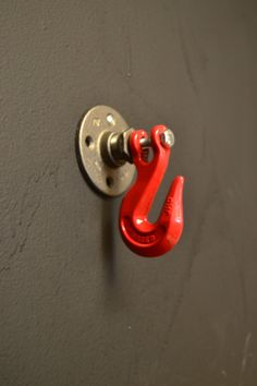 This wall hook will make sure you never lose your towel hat, clothes, anything -- and itll look good doing it! Its made using steel pipe hard bottom and a red hook. Itll add industrial charm to any home, retail space, or office. It can be hung with just one screw. ITEM SPECIFICS: