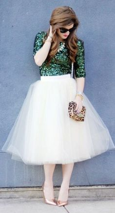 Chic in all black like a fashionista ballerina.        Black top and cute peach tulle skirt.      Sparkly top, tulle skirt and leopard pr...