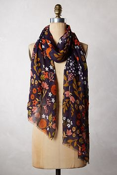 A print scarf with rich colors paired with a tweed jacket or houndstooth sweater liven up what could be a drab conservative approach. It's also a great trick for wearing very angular prints by breaking it up with rounded prints by the face. Frolicking Fox Scarf - anthropologie.com