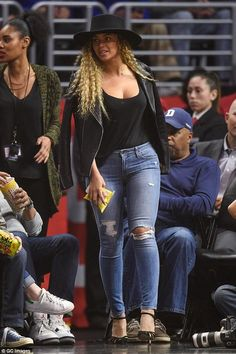 Beyonce Knowles wearing Genetic Denim Shya Cigarette Distressed Jeans in Torch, Saint Laurent Classic Leather Motorcycle Jacket, Gianvito Rossi Suede and Mesh Pumps and Janessa Leone Gabrielle Hat