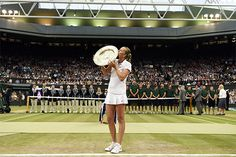 Petra Kvitova kissed the Venus Rosewater Dish on Centre Court