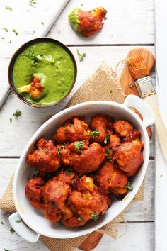 Amazing, spicy red curry cauliflower wings that are baked not fried, gluten free, and require just 9 ingredients! Pair with my simple green chutney.