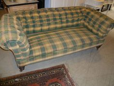 Antique victorian maogany framed chesterfield sofa on turned feet and brass castors ,springing all sound. 195 cm wide 95 cm deep ,70 cm high