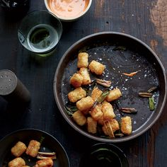 This Tater Tots recipe features a creamy, spicy sauce that's a mix of homemade aioli and two hot sauces. Get the recipe at Food & Wine.
