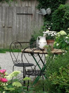 Bistro table and chairs in a lovely shady part of the garden.....perfect for our morning coffee break