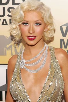 puts good taste through the wardrobe wringer. All crass and no class. Aguilera wears a multi-strand draped necklace with a dress that contains even more metal at the 2006 MTV Video Music Awards in New York on Aug. 31, 2006.