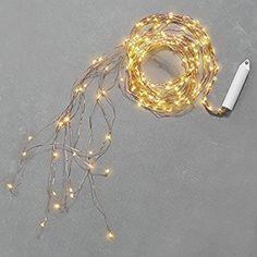 Amazon.com: 8.5 ft. Copper Spray Fairy Lights, 180 Warm White LEDs, 9 Strands, Cascading Garland Light, Water Resistant, Indoor/Outdoor, Battery Operated, Timer Option Included: Home & Kitchen