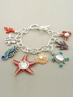 Designer Inspired Silver Nautical Bracelet. 1 ~ 1 1/2 Inch L Charm - Starfish / Coral / Shell / Fish / Seahorse / Turtle / Crab / Sea - Crystal / Epoxy / Metal - Toggle - 8 Inch Bracelet Length Hail Mary Gifts,http://www.amazon.com/dp/B00CS7AFVM/ref=cm_sw_r_pi_dp_1XYRrb746EAB4599