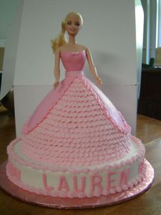 Barbie Doll Cake - The mother of the birthday girl wanted a real Barbie used instead of the doll pick.  Made for a taller cake....which in my opinion actually looks better than using the pick.  The bodice was done with fondant, the skirt is all buttercream.